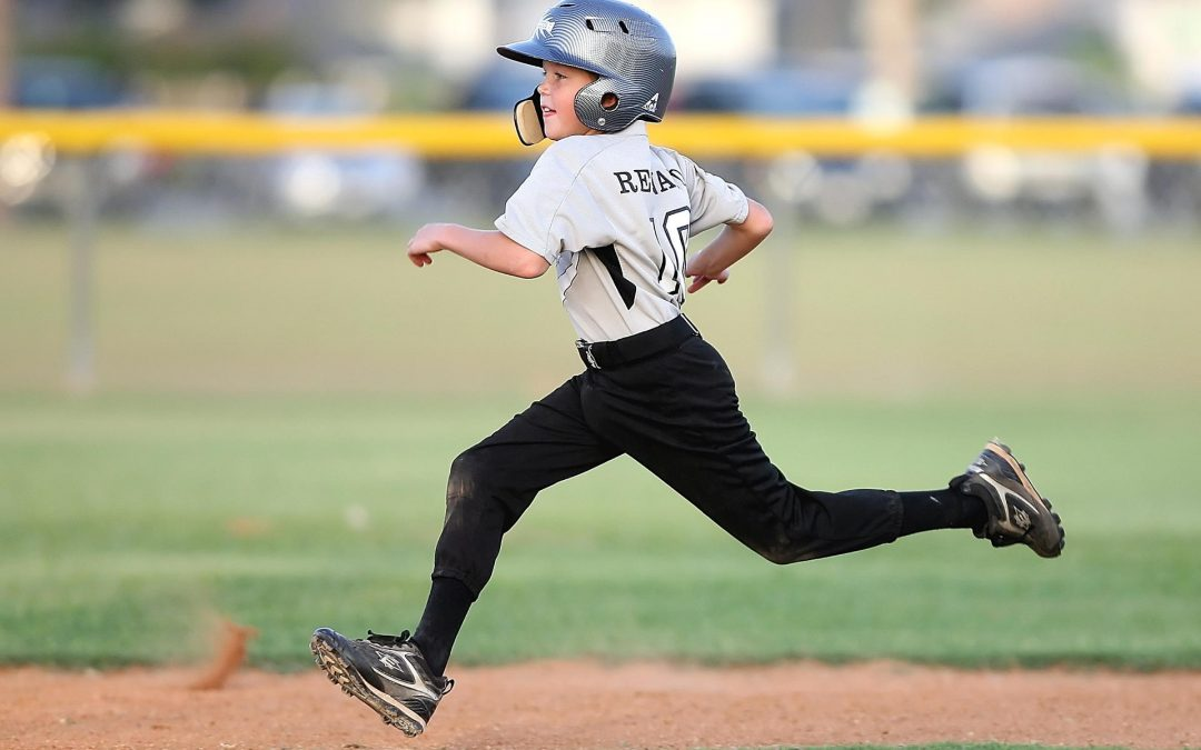 Child Running the Bases Playing Baseball