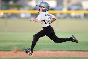 Child Running the Bases Playing Baseball
